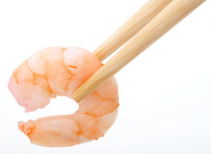 Healthy food, peeled prawn and chop sticks