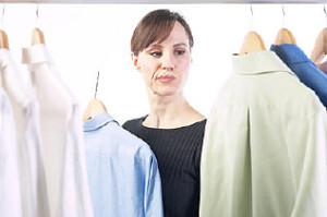 Woman picking out a shirt uid 1343148