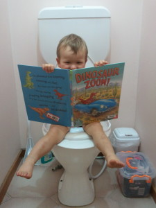 Happy to be on the toilet. Almost 2 years old.